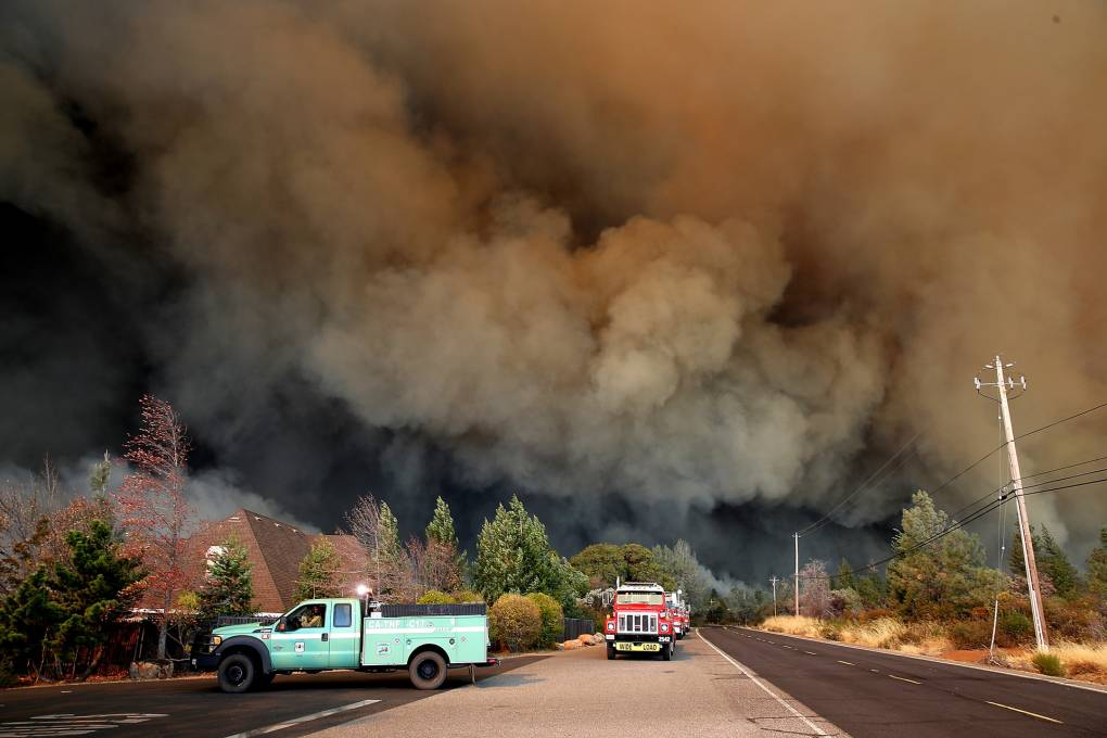 A plume of smoke rises above the Camp Fire as it moves through the area on November 8, 2018 in Paradise, California.
