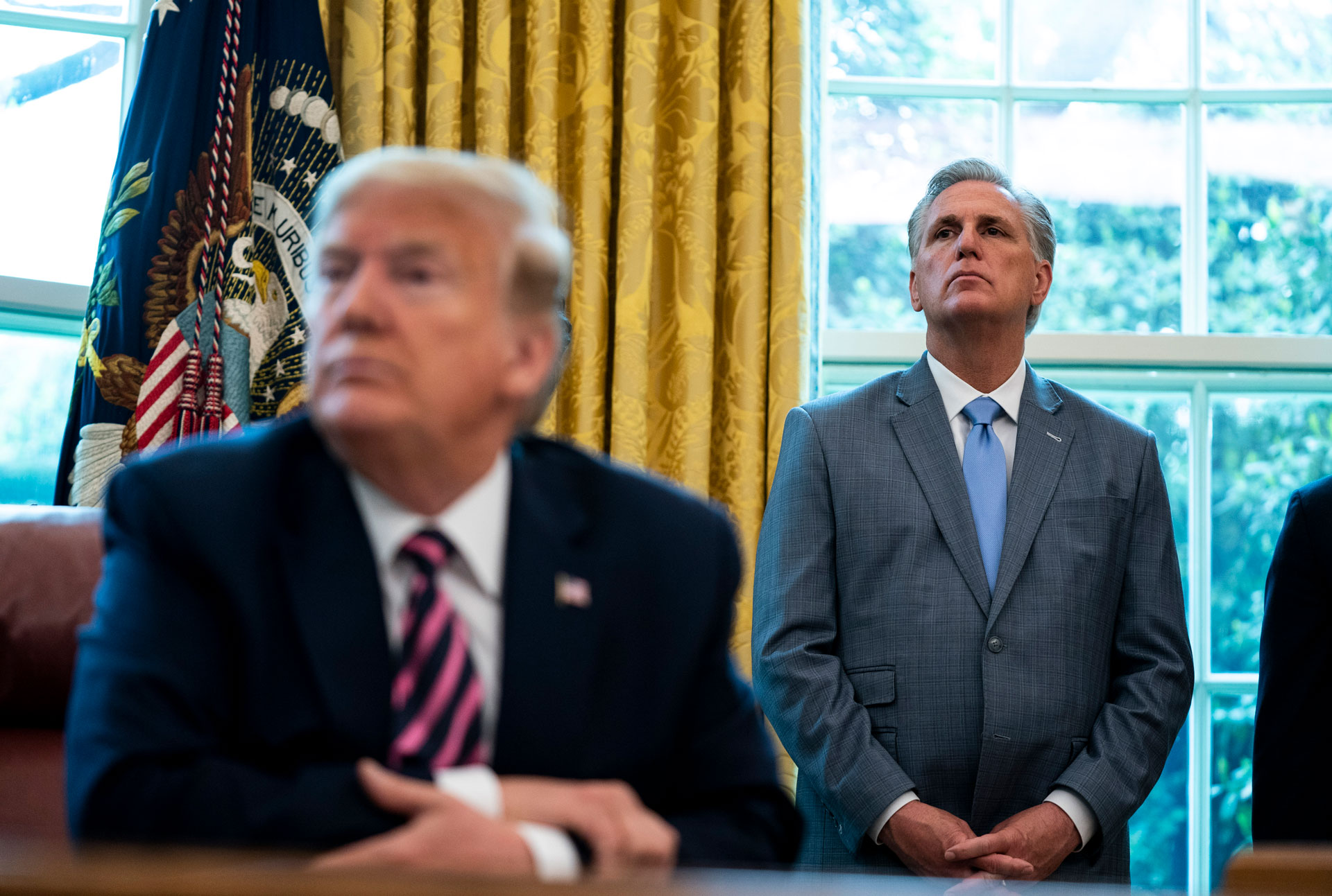 Kevin McCarthy stands behind Trump in the Oval Office