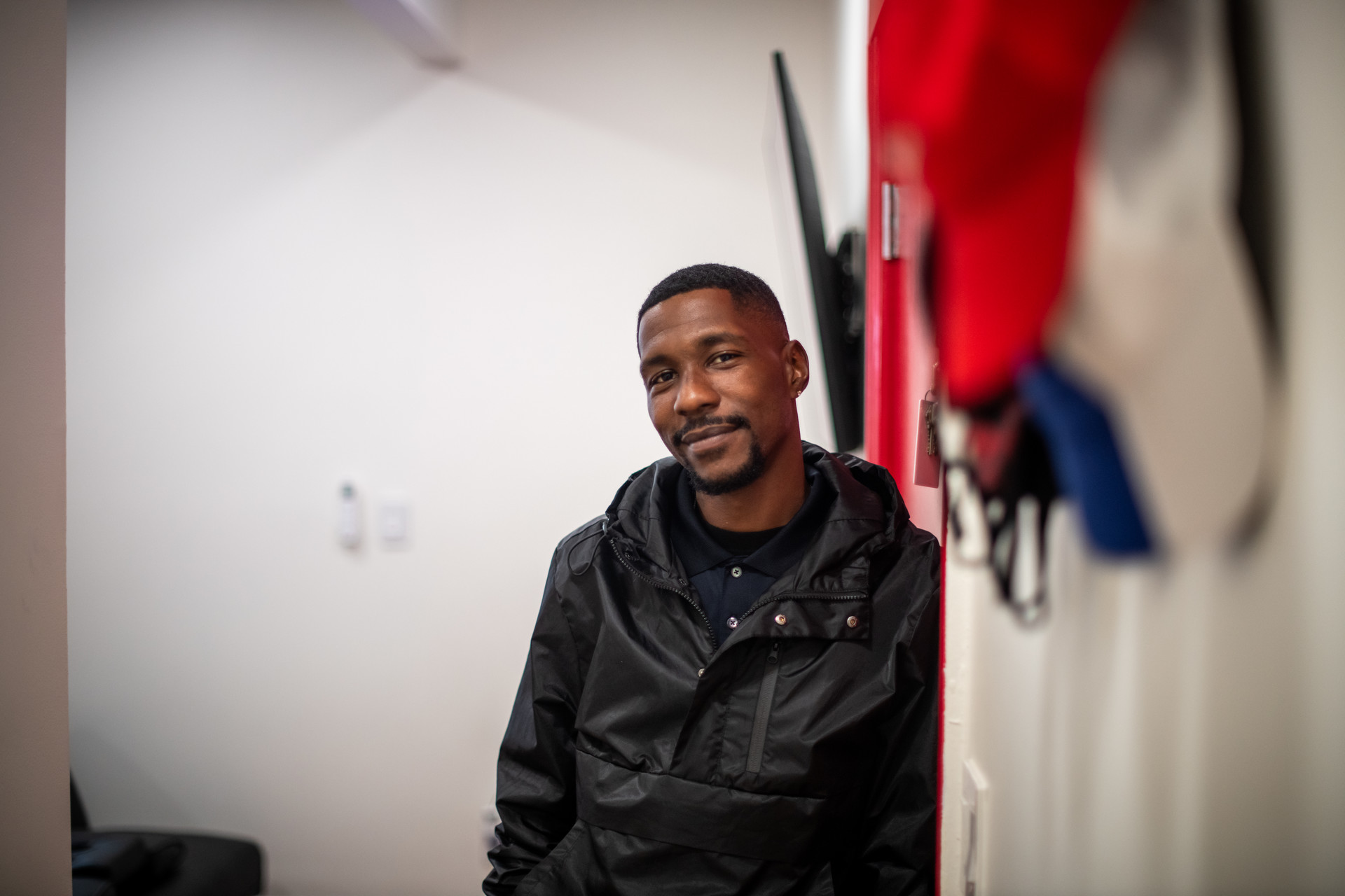 Marquisse Moore smiles inside his home