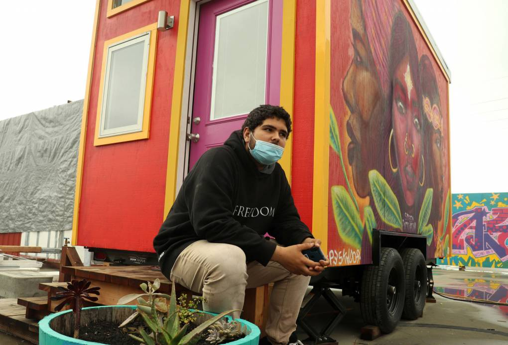 'A Beacon of Light': Unhoused Youth Move Into Oakland's New Tiny House Village | KQED
