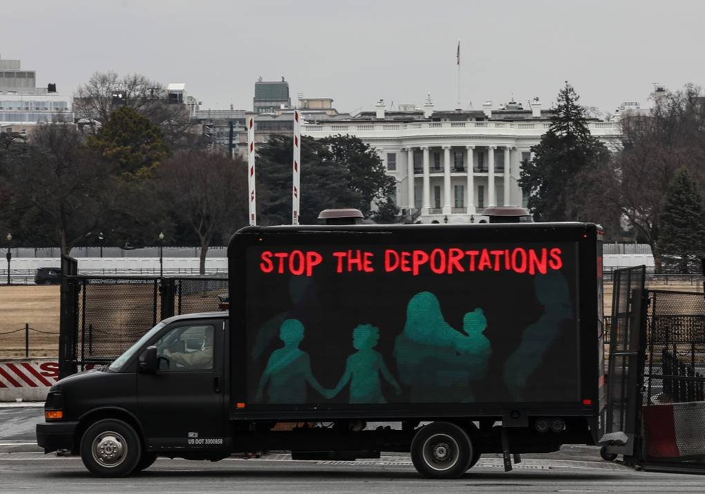 An L.E.D. truck displaying messages expressing concern over the continuing mass deportations of Black immigrants drives past the White House prior to a #BidenAlsoDeports rally on February 15, 2021 in Washington, DC.