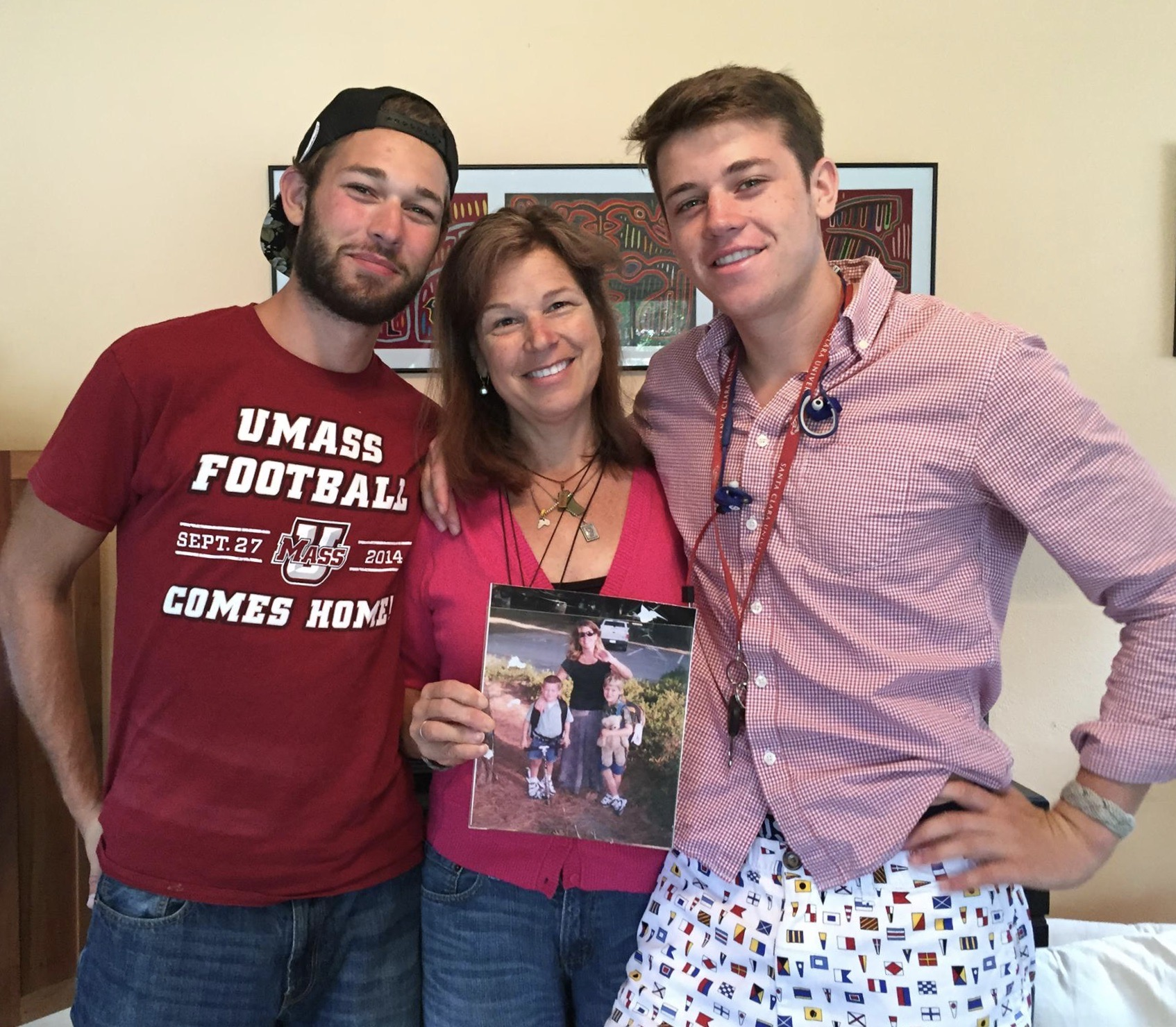 Penny Nelson with her sons James (L) and Misha (r).