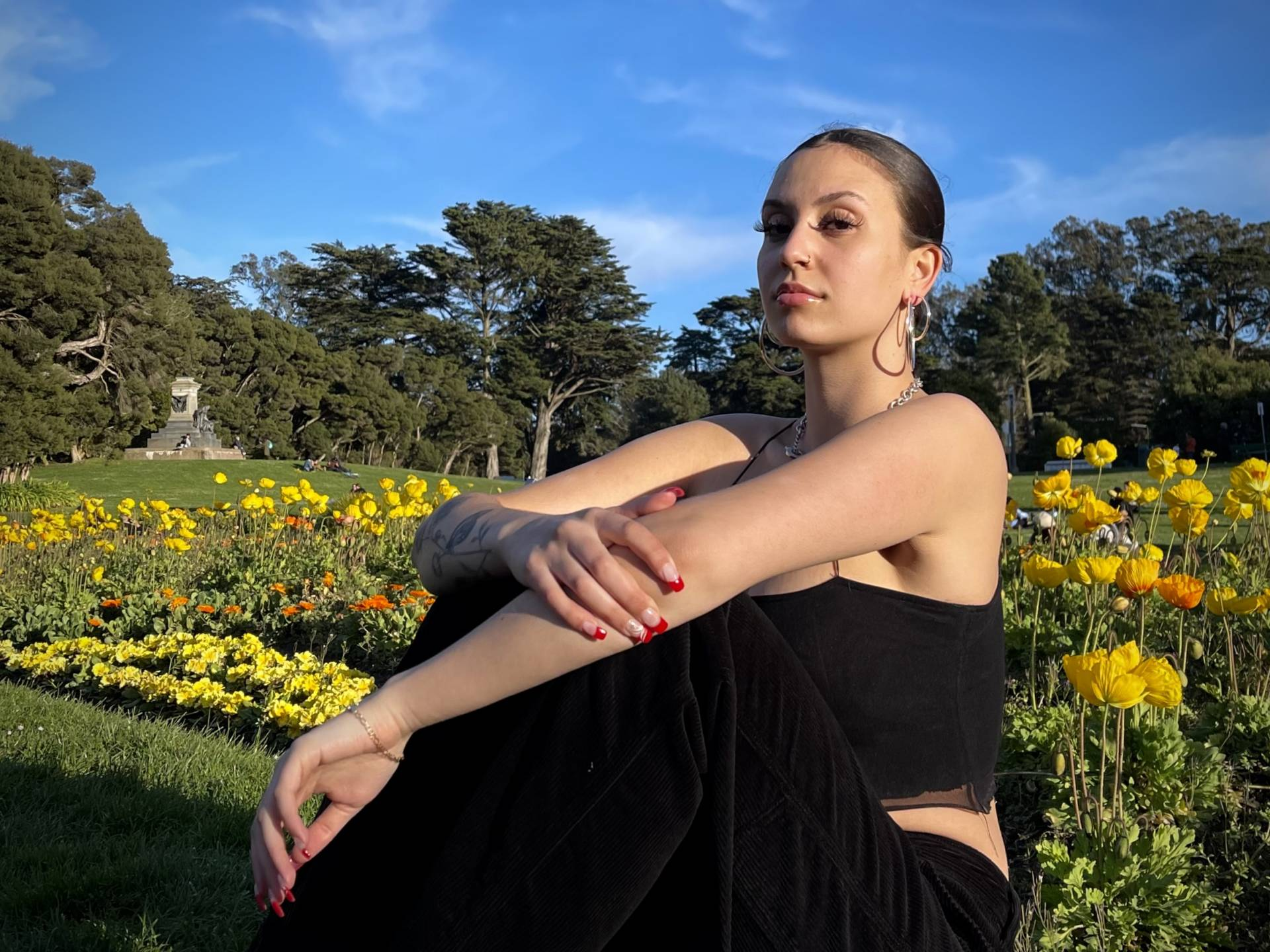 Ayisha Friedman sitting outside, arms crossed