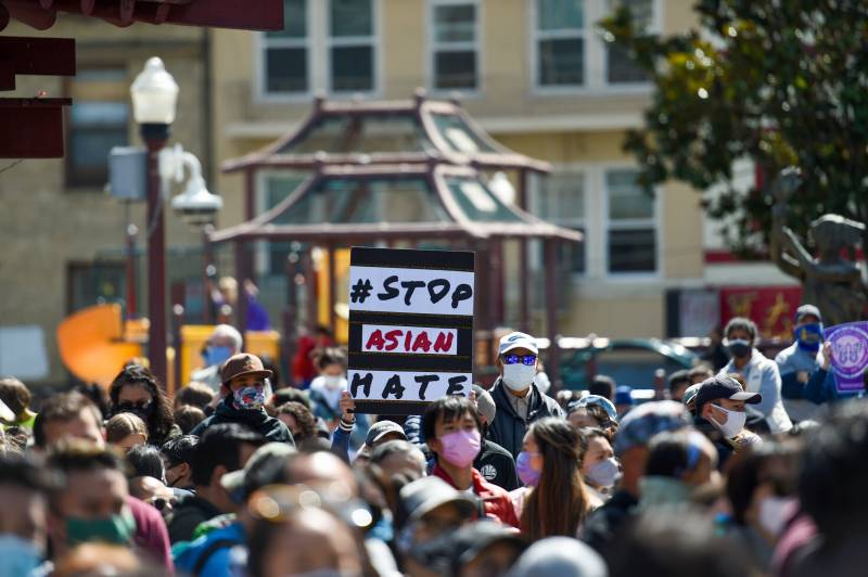 A group of demonstrators hold signs that say, 'Stop Asian Hate' during a vigil and rally in San Francisco's Chinatown on March 20, 2021.