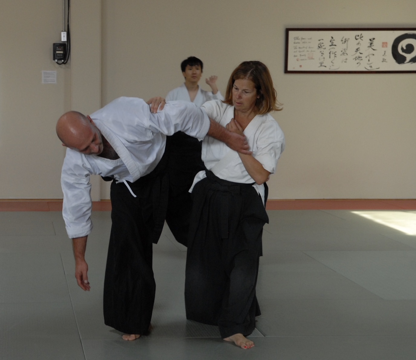 Penny Nelson demonstrates proper form at her dojo, Aikido West.