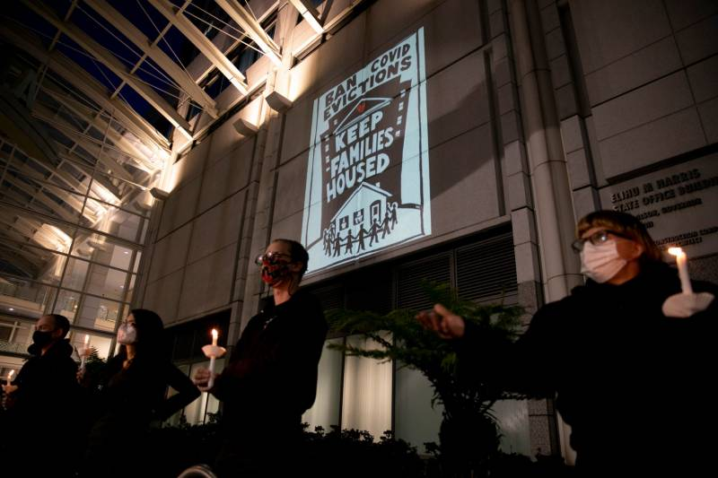 Housing activists and rent strikers participate in a vigil for tenants who they say will not be covered by Gov. Gavin Newsom's rent relief plan at the Elihu M. Harris, State of California office building in Oakland on Jan. 29, 2021.