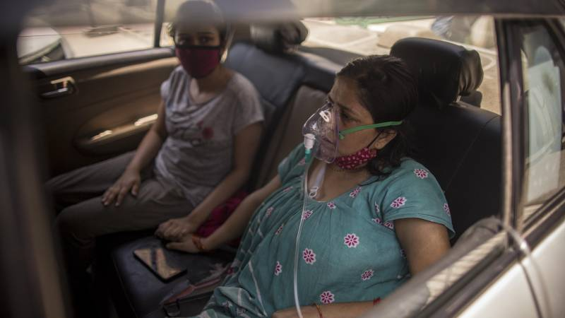 Patients infected with COVID-19 can be seen wearing Oxygen masks place amid the rising concerns over lack of Oxygen on April 24, 2021 in New Delhi, India. With recorded cases crossing 300,000 a day, India has more than 2 million active cases of COVID-19, the second-highest number in the world after the U.S. A new wave of the pandemic has totally overwhelmed the country's healthcare services and has caused crematoriums to operate day and night as the number of victims continues to spiral out of control.