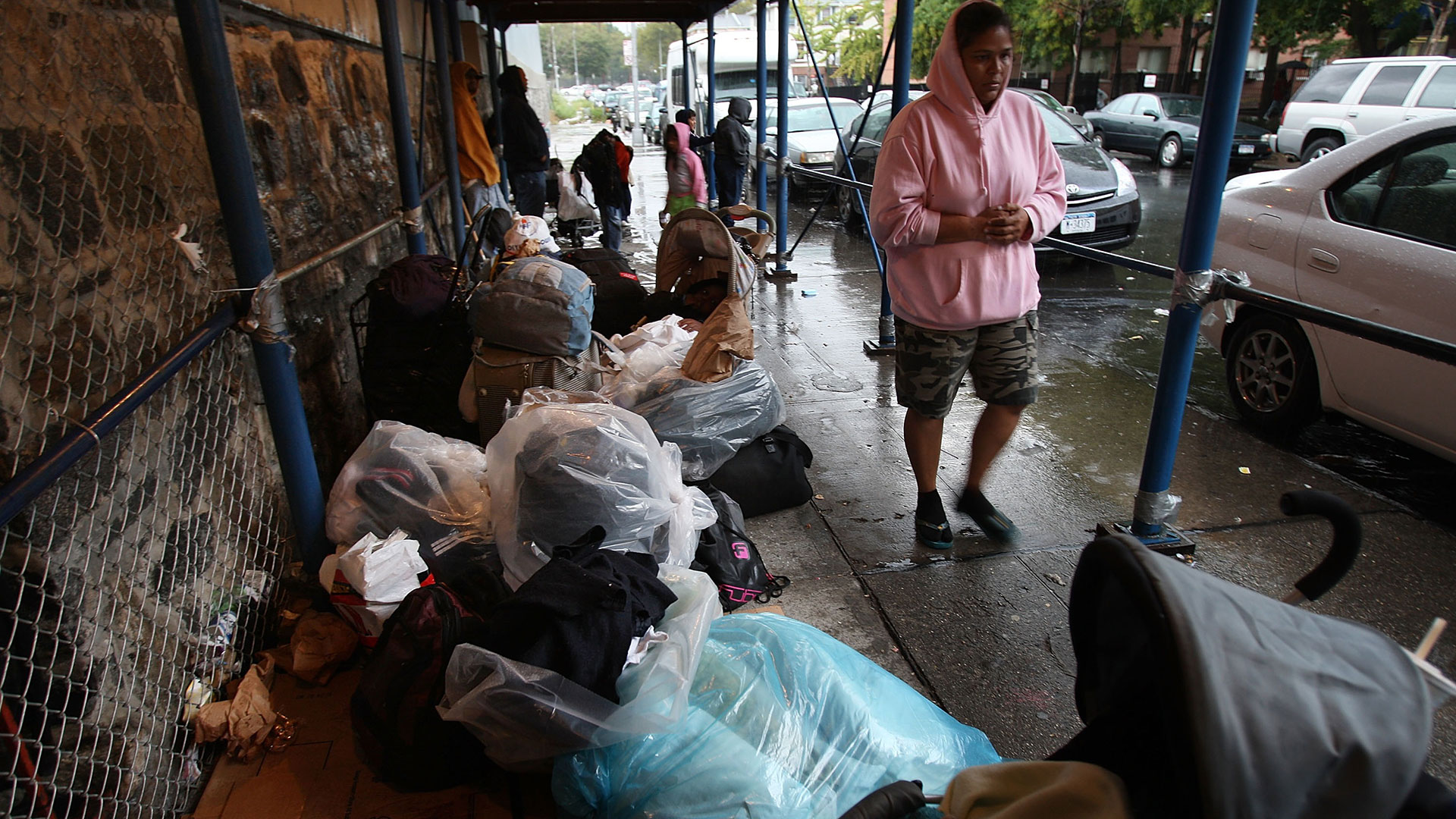 Families who are homeless wait to get into an emergency shelter in New York City.