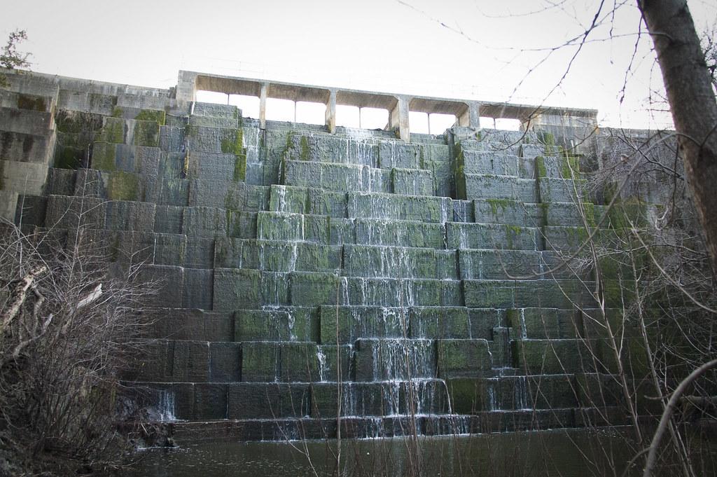 Searsville Dam is a concrete gravity structure made of interlocking concrete blocks.