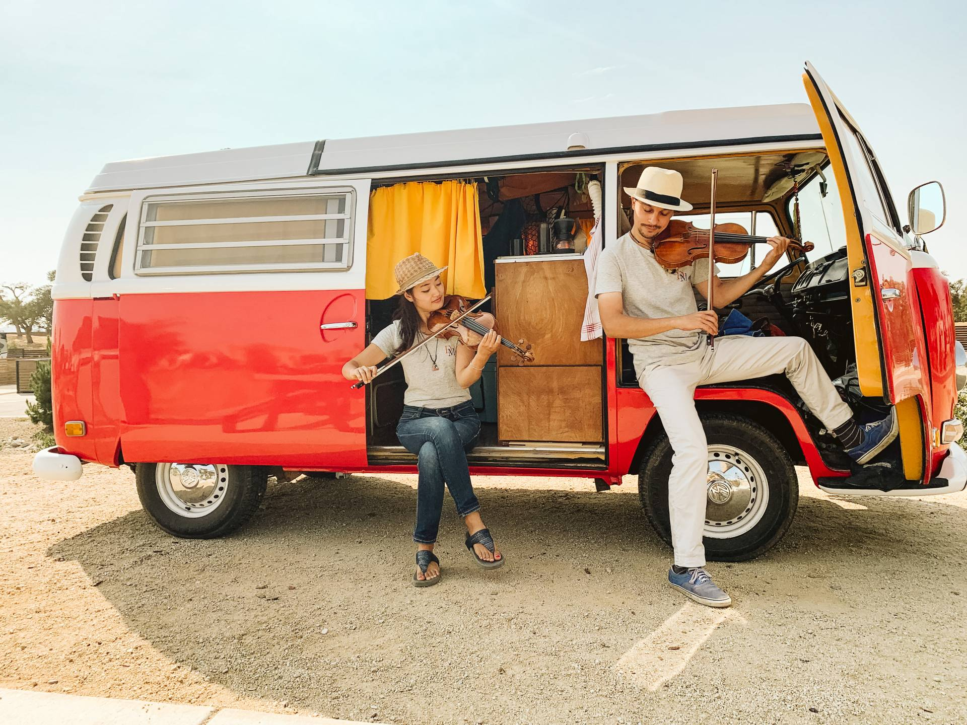 MusiKaravan violinists Etienne Gara and YuEun Kim in Paso Robles with their bright red 1971 VW bus named Boris. Courtesy Lathan J.