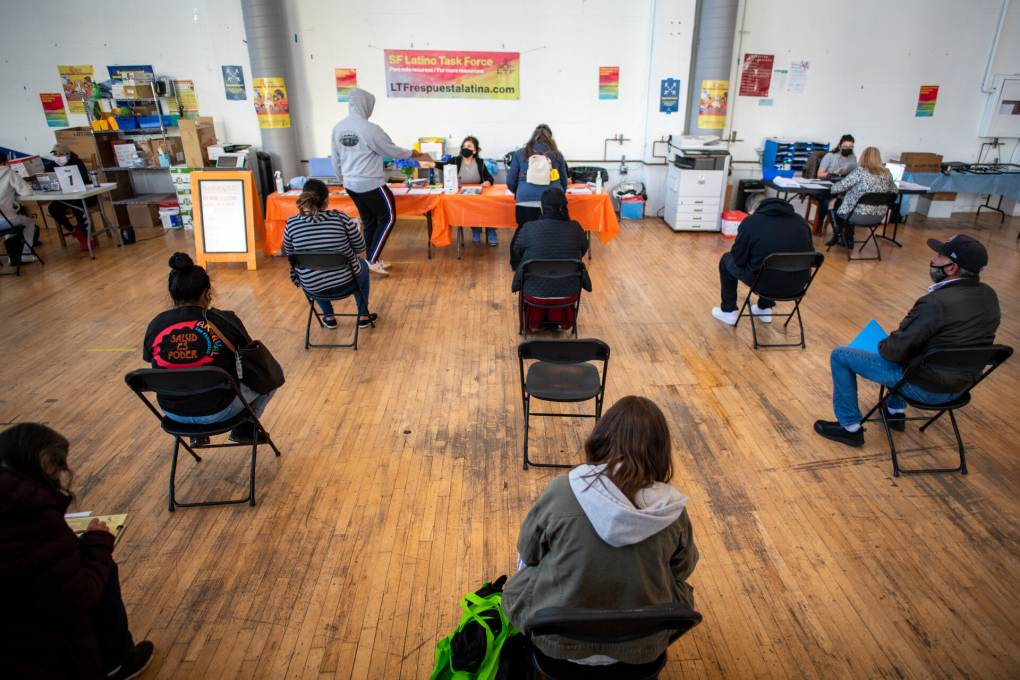 People wait for tax help at the Mission Food Hub in San Francisco on May 19, 2021.