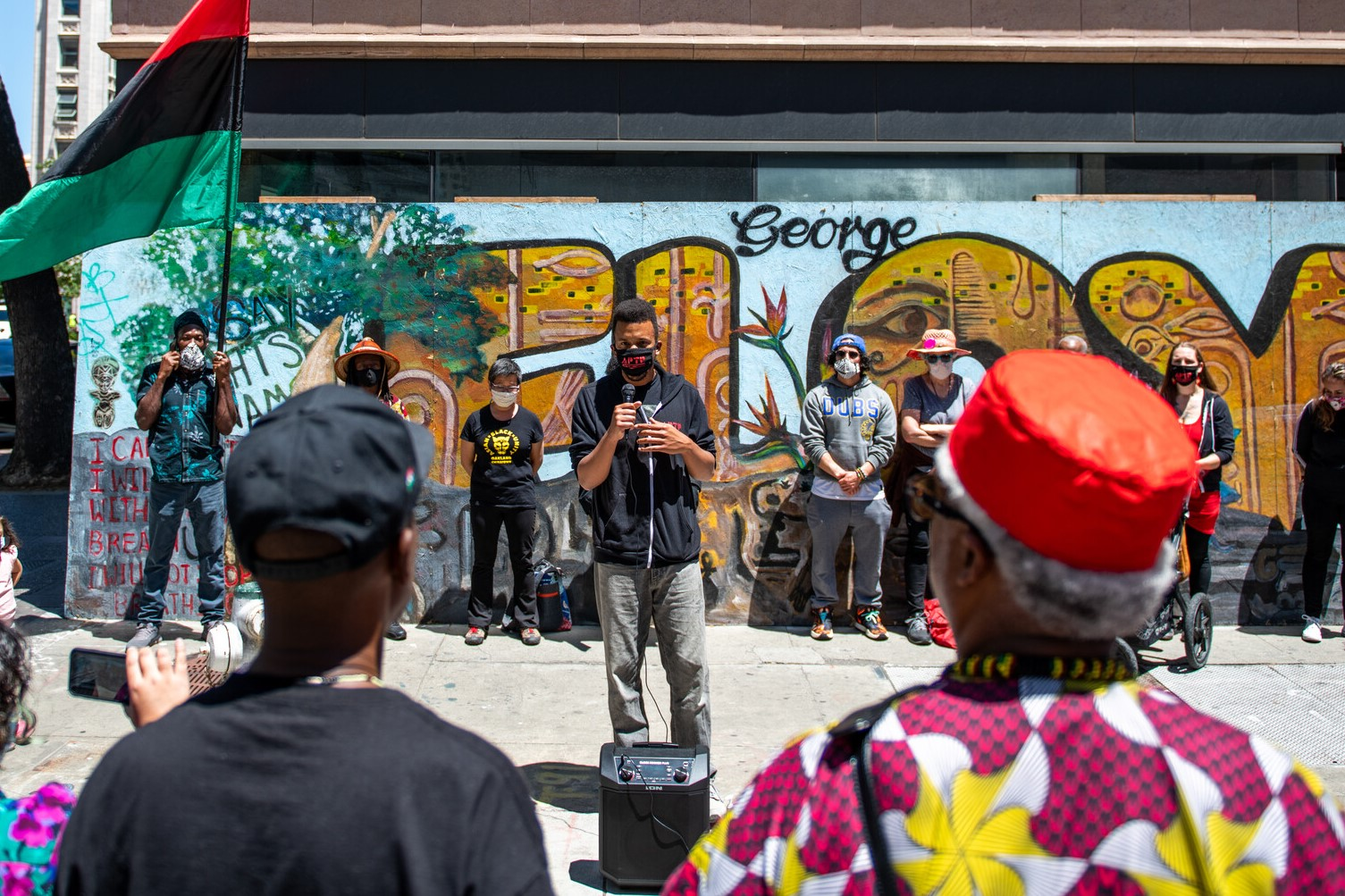 James Burch from Anti-Police Terror Project (APTP) speaks to a crowd in Oakland on May 25, 2021.