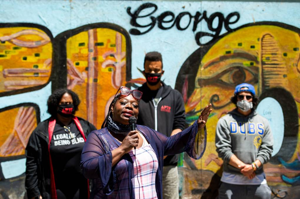 Barbara Doss, mother of Dujuan Armstrong, speaks to a crowd in Oakland.