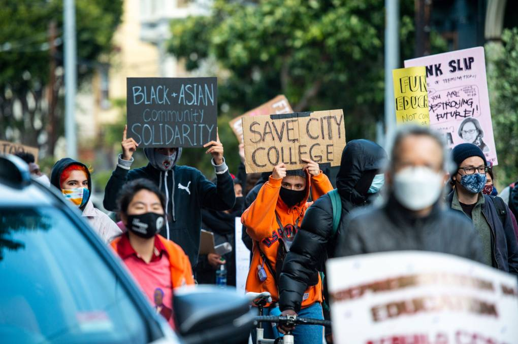 Demonstrators march through the Castro neighborhood during a rally in San Francisco on May 6, 2021, to protest layoffs and cuts at City College of San Francisco. Beth LaBerge/KQED