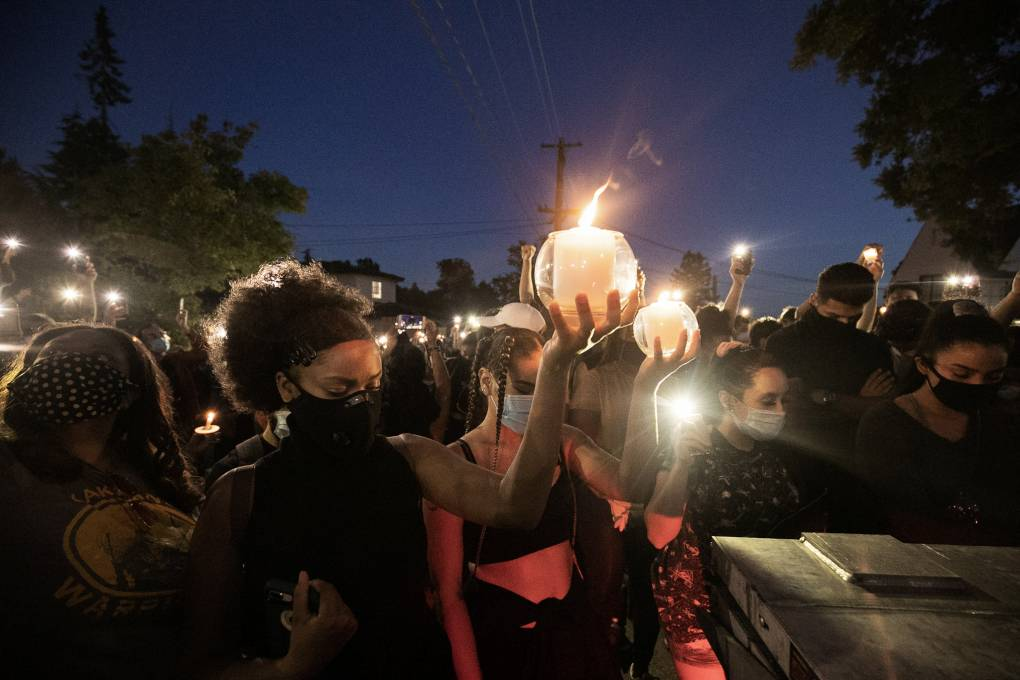 A candlelight ceremony at night to remember the death of George Floyd, who was murdered by a Minneapolis police officer.