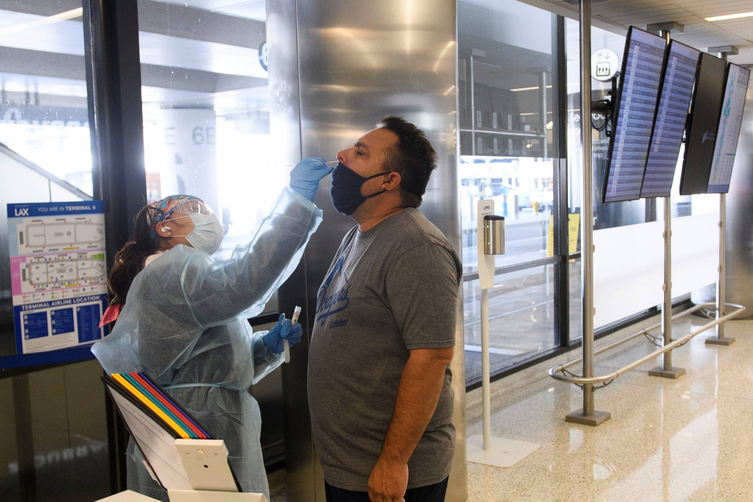 A traveler receives an in-airport Covid-19 nasal swab test a day before his flight to Hawaii at Los Angeles International Airport (LAX) in Los Angeles on Nov. 18, 2020.