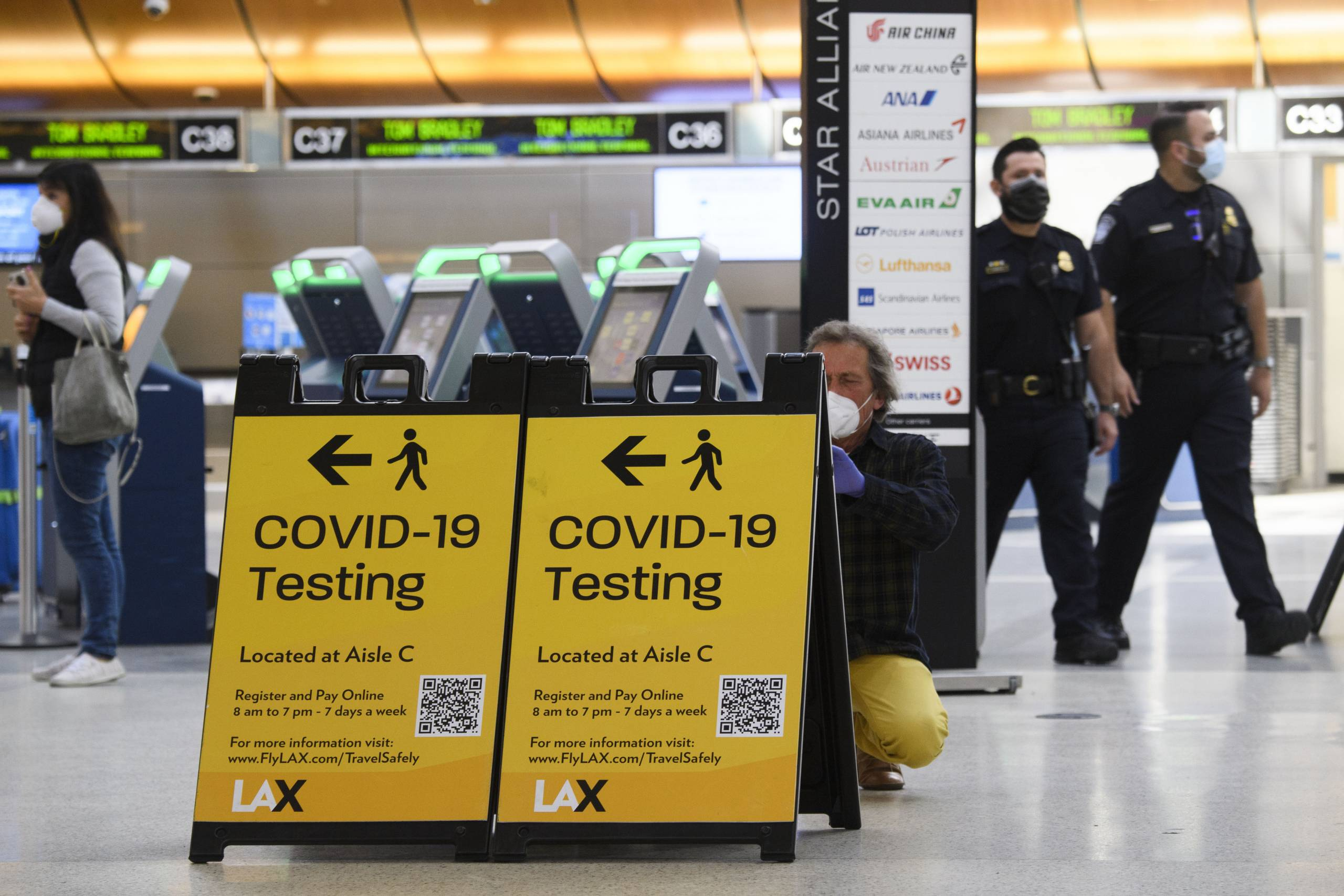 A coronavirus testing sign at Los Angeles International Airport (LAX) on February 4, 2021 in Los Angeles.
