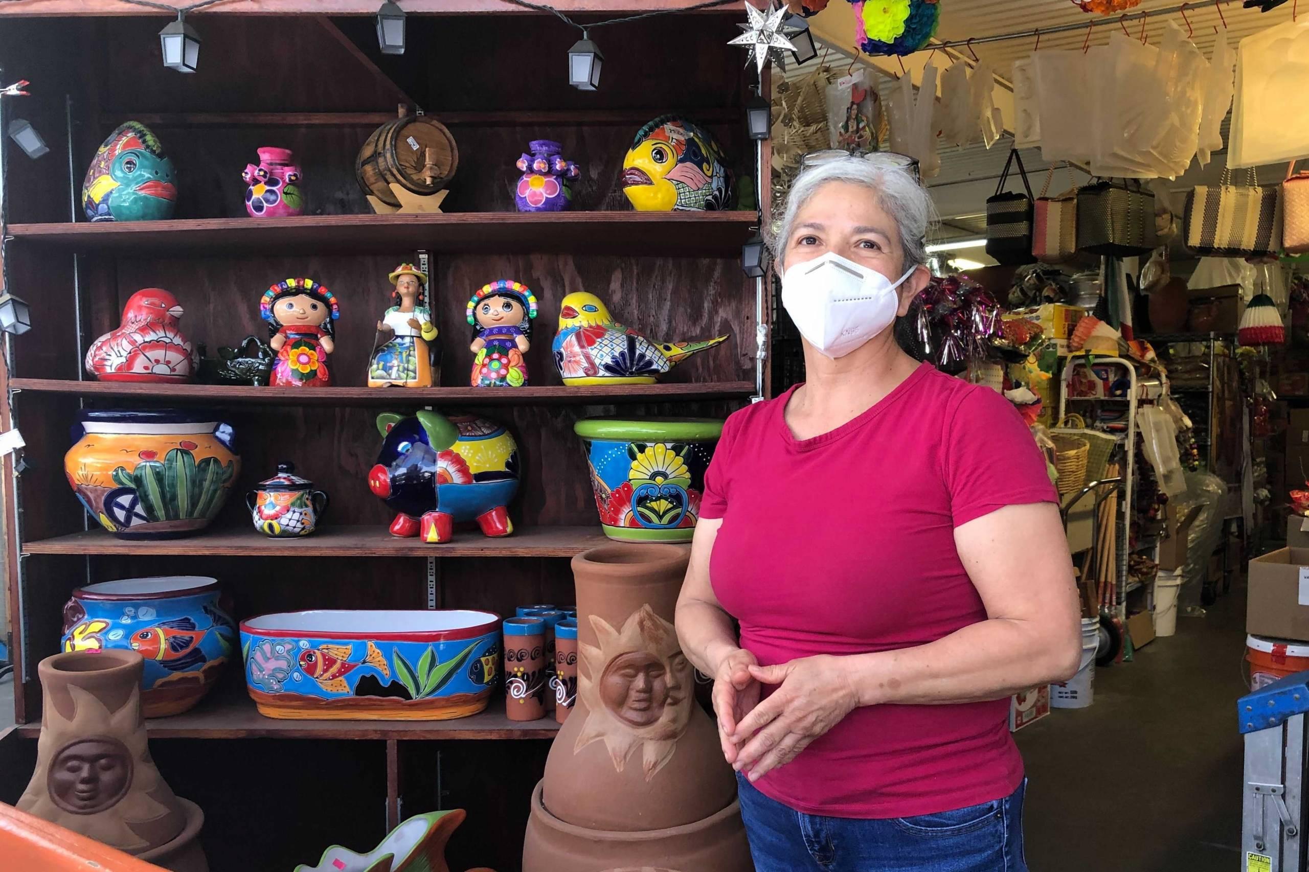 Ana Vázquez, a merchant at the San Jose Flea Market, stands next to her stall.