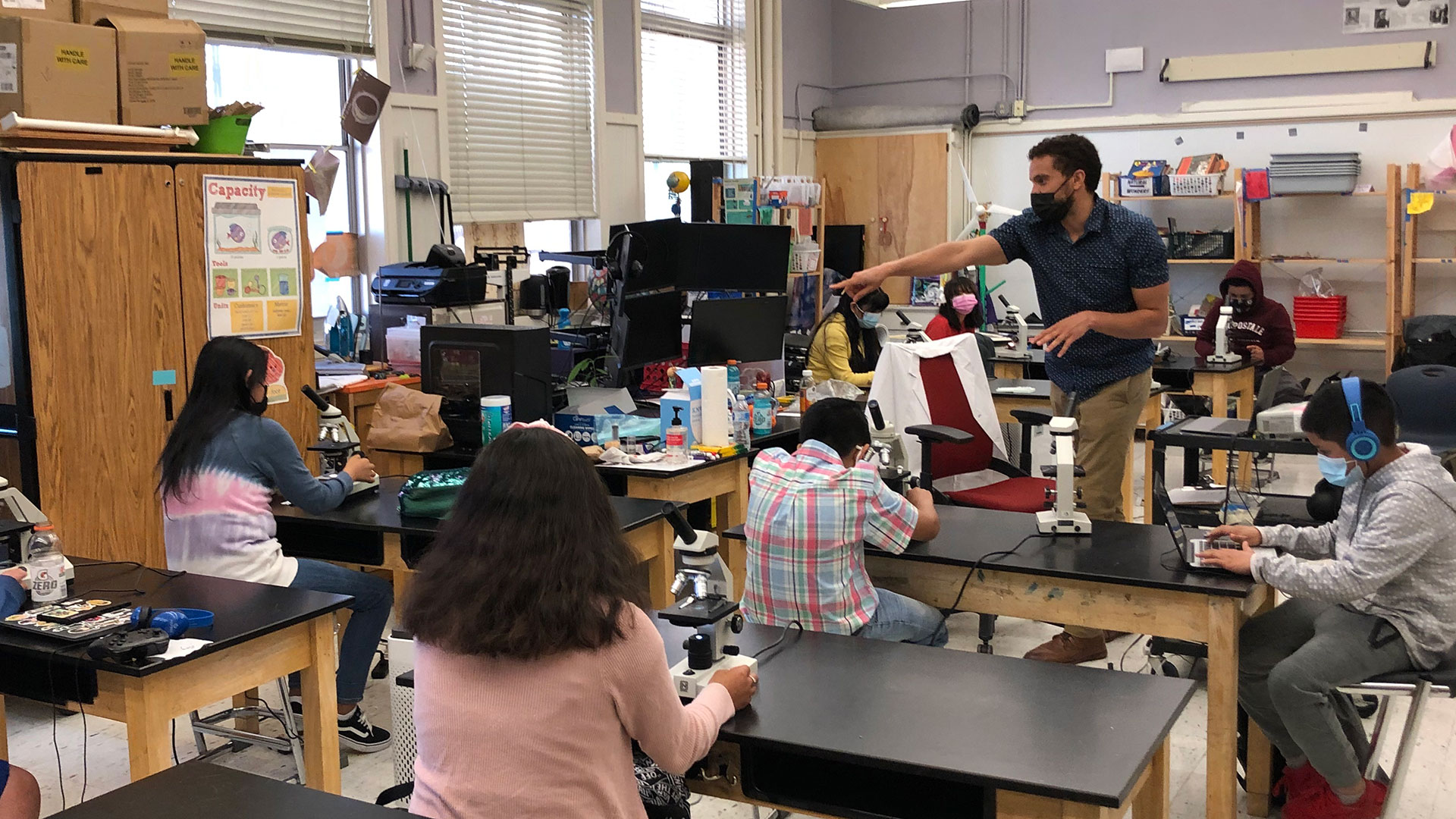 Sixth grade teacher Patrick Messac teaches a science class at Life Academy of Health and Bioscience in East Oakland. Students are studying the health impacts of air pollution and asking questions about their own exposure.