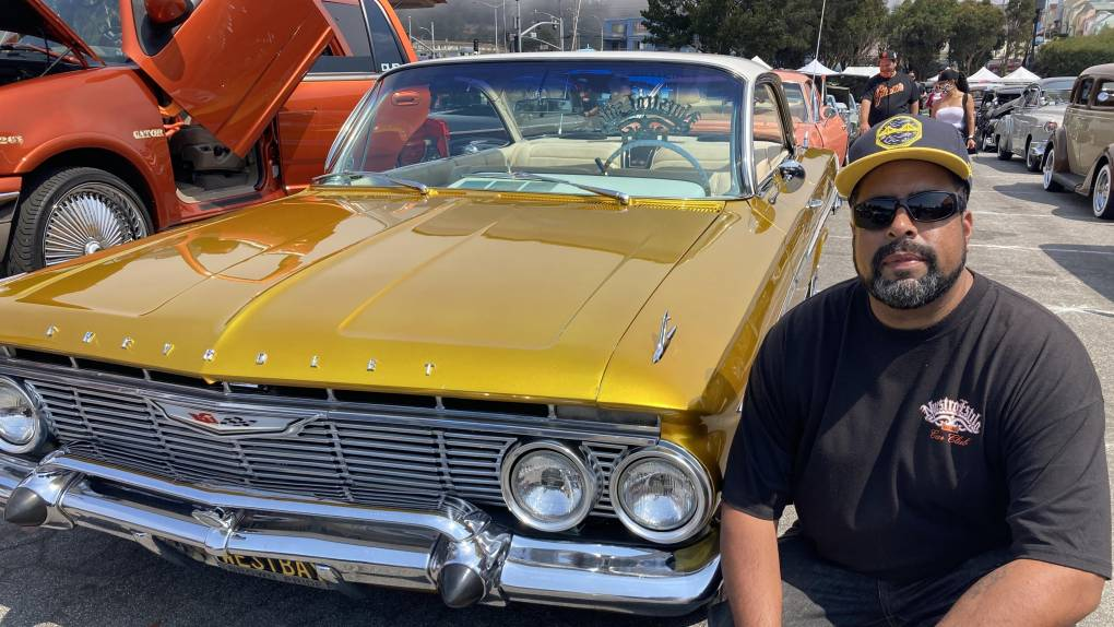 man with yellow lowrider car
