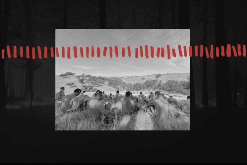 A black-and-white photo of a group of firefighters lying on the grass, overlaid with a graphic of a dotted red line.