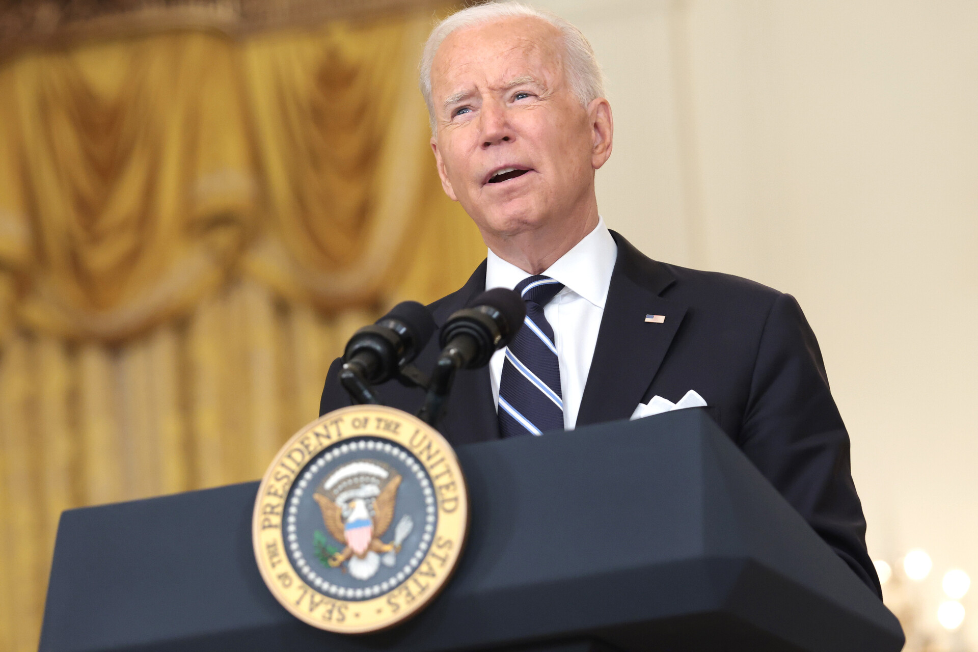 President Biden speaks at a podium.