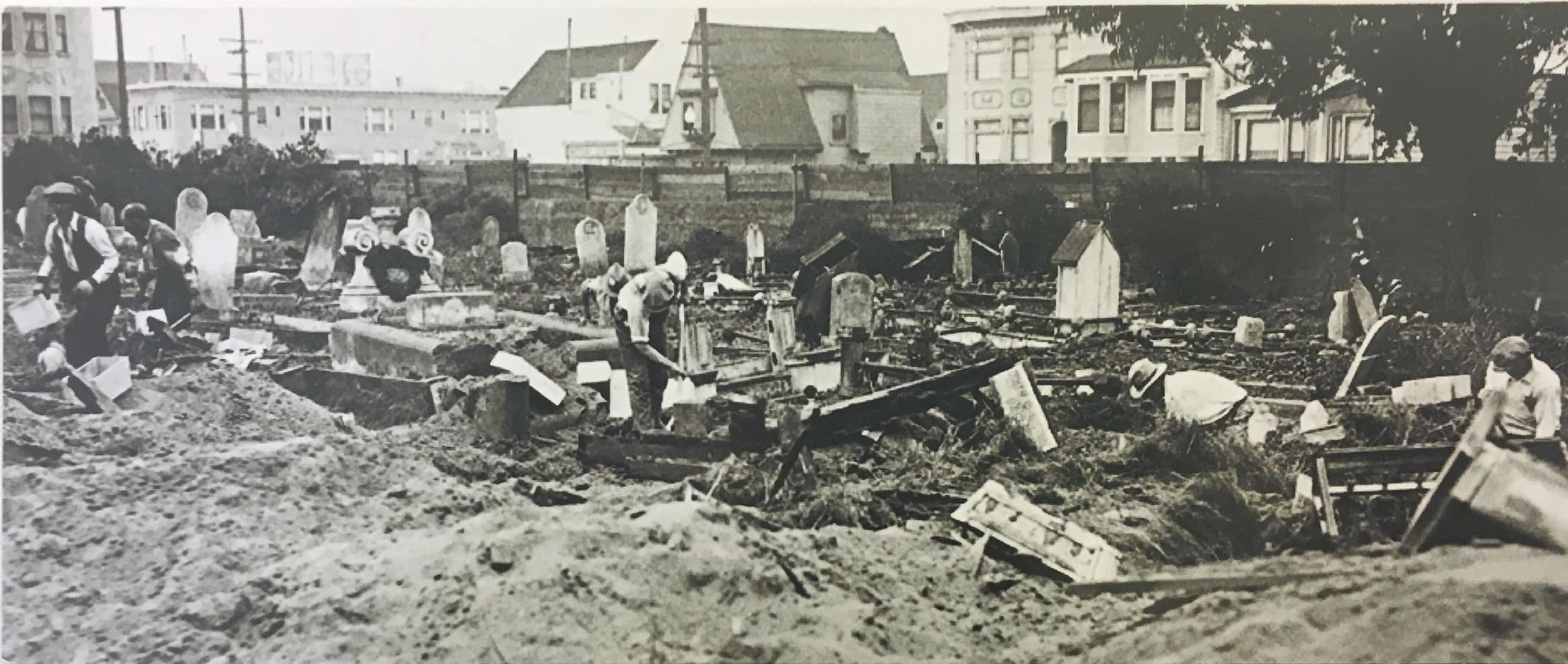 Workers remove bodies from the Odd Fellows cemetery. (Colma Historical Association)