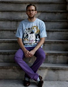 This is Todd Selby, from theselby.com. I hate this!  I hate that he wears an ironic cat shirt with funky socks with loafers when I would wear the same shirt with LOVE.