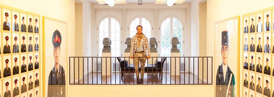 Fashion designer, Wolfgang Joop, in his AMAZING Berlin mansion, flanked with Collier Schorr photographs.