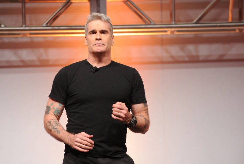 Look how much better Henry Rollins looks in a black t-shirt and pants, compared to his naked performance below. If all else fails, go for black jeans and a t-shirt, any time.