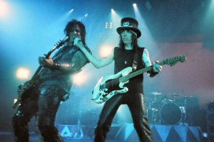 Nikki Sixx and Mick Mars performing in 2005. Image via Wikipedia Commons.