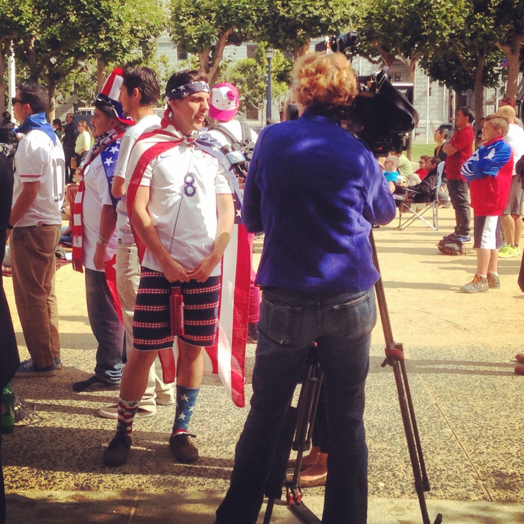 Local news goes for the obvious interview ahead of the US game. Civic Center Plaza (July 1, 2014)