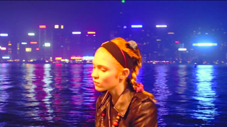 "Grimes Surprise Drops Music Video for Demo from Her ""Lost Album"""