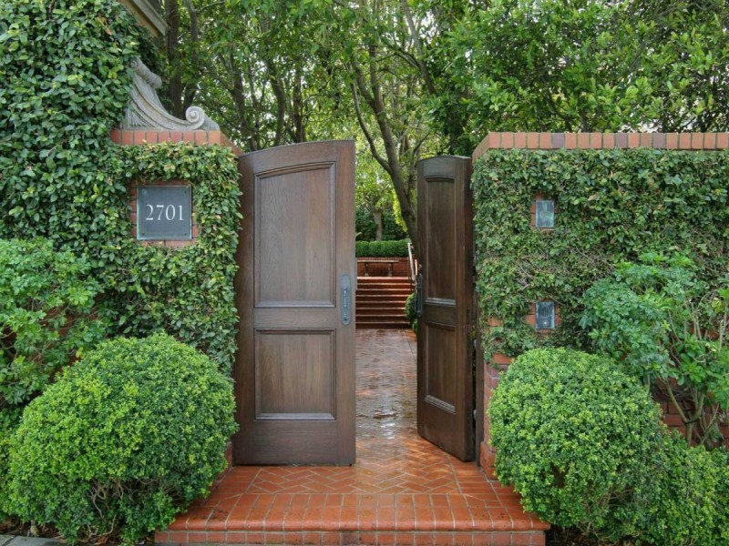 enter-the-home-through-a-door-in-an-ivy-covered-wall