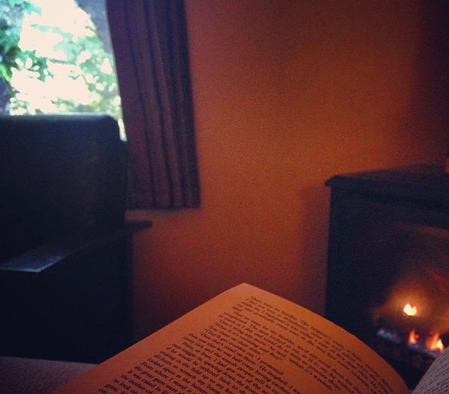 Heaven is a Sunday morning read in front of a fireplace in one of Fernwood's motel rooms