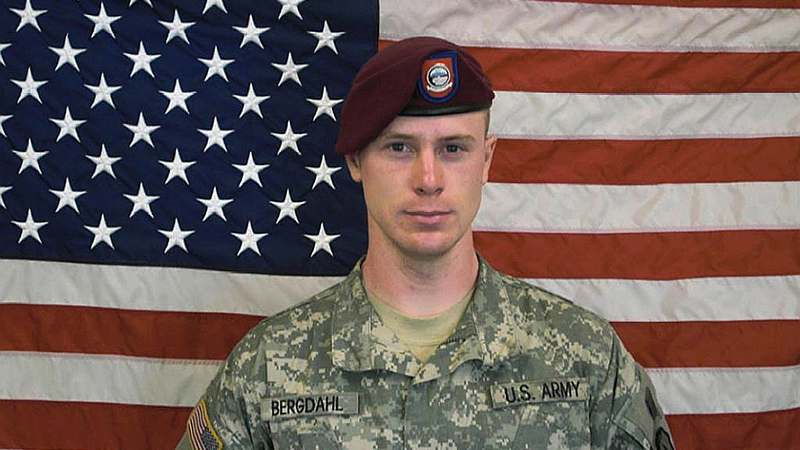 UNDATED - In this undated image provided by the U.S. Army, Sgt. Bowe Bergdahl poses in front of an American flag.