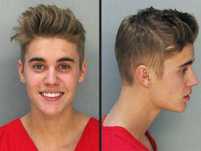 The infamous mug shot: not exactly the face of remorse.
