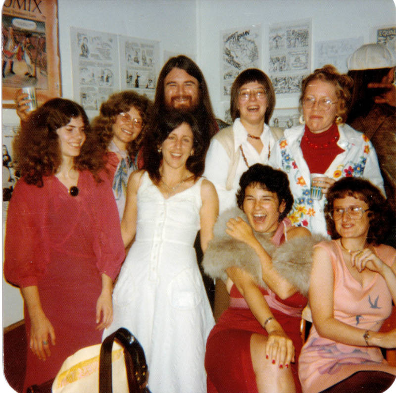The women of Wimmen's Comix at a gallery show of their work in 1975, with Last Gasp publisher Ron Turner.