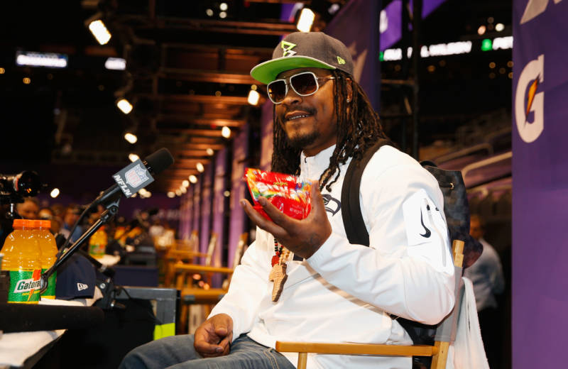 Marshawn Lynch eats Skittles as he addresses the media at Super Bowl XLIX Media Day in 2015.