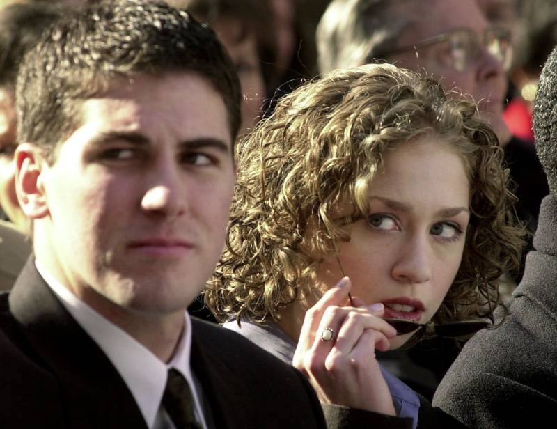 WASHINGTON, : Chelsea Clinton looks on with an unidentified friend from Stanford University 31 December 1999 at America's Millennium Opening Ceremony in Washington, DC. (Photo: JOYCE NALTCHAYAN/AFP/Getty Images)