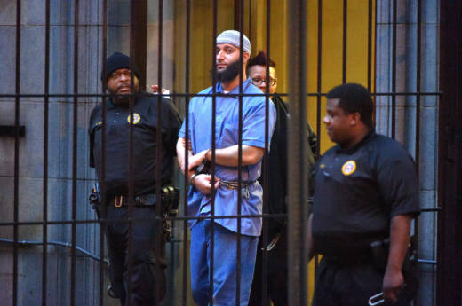 Officials escort Serial podcast subject Adnan Syed from the courthouse on Feb. 3 following the completion of the first day of hearings for a retrial in Baltimore. A judge granted the new trial -- and now Syed has requested that he be released on bail while he waits for the retrial. Photo: Karl Merton Ferron/Baltimore Sun/TNS via Getty Images
