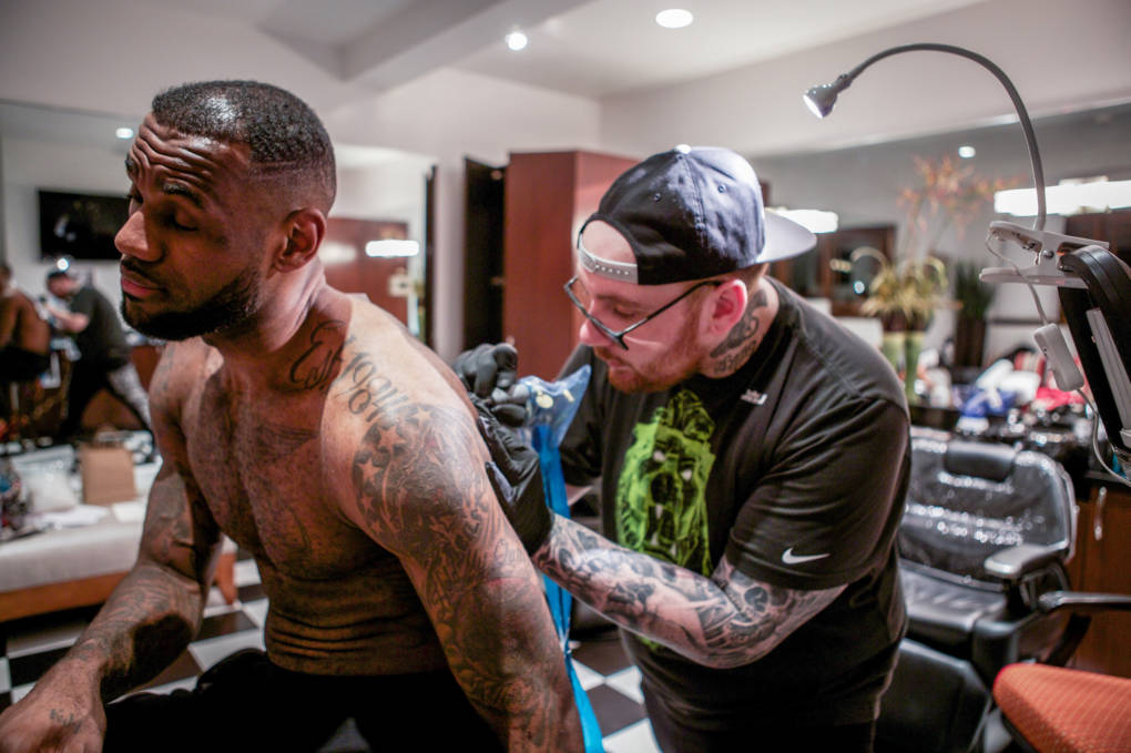 "Tattoo artist Keith ""Bang Bang"" McCurdy works on NBA star LeBron James."