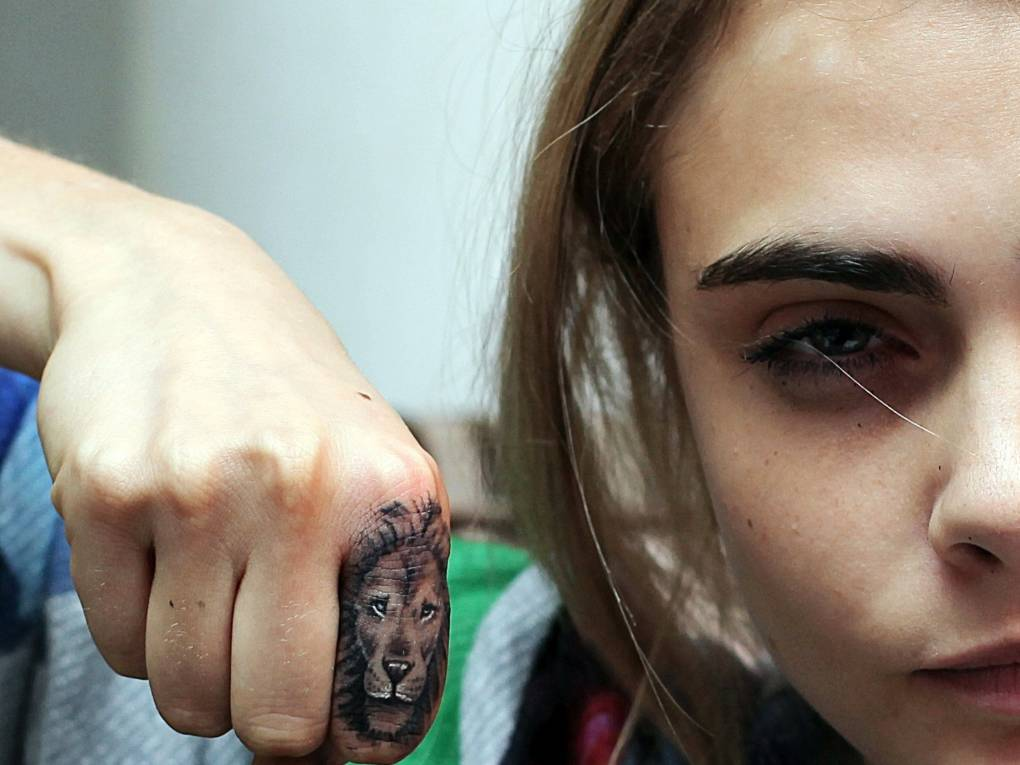 Bang Bang gave Cara Delevingne's this lion tattoo.