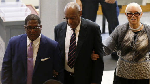 Bill (C) and Camille Cosby and aide Andrew Wyatt enter the Montgomery County Courthouse on June 12, 2017 in Norristown, Pennsylvania.