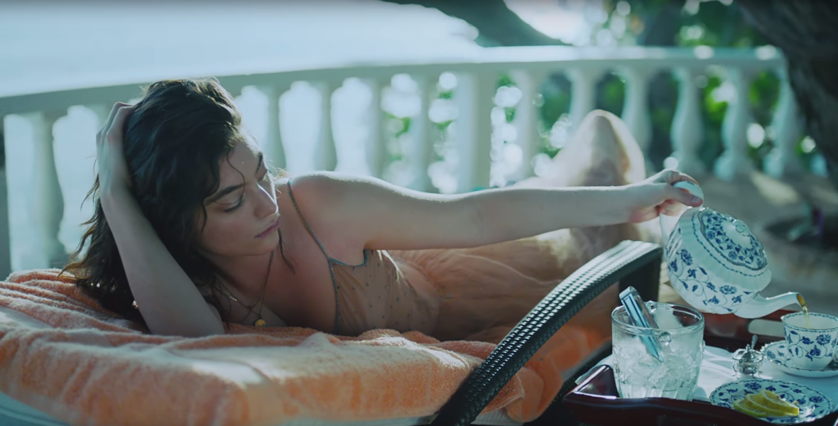 """Lorde Gets Drunk in a Waterfall and Swings from Tree Vines in Gorgeous """"Perfect Places"""" Video"""