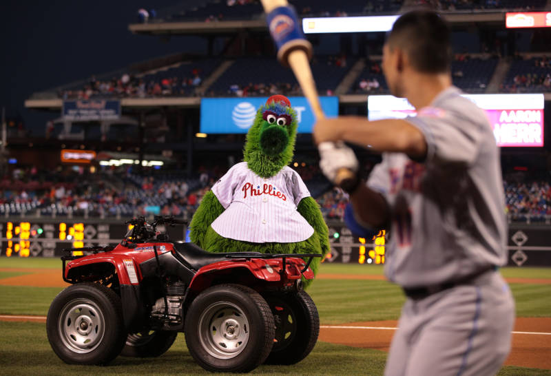 The Phillie Phanatic stares down Norichika Aoki of the New York Mets, Citizens Bank Park, Philadelphia, 2017.