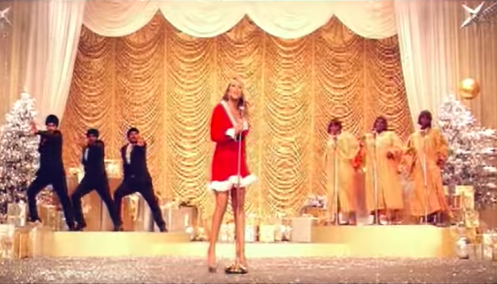 """A very '50s party, courtesy of Mariah (""""Oh Santa!"""")"""
