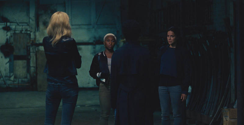 L-R: Elizabeth Debicki (back to camera), Cynthia Erivo, Viola Davis (back to camera), and Michelle Rodriguez star in 'Widows'.