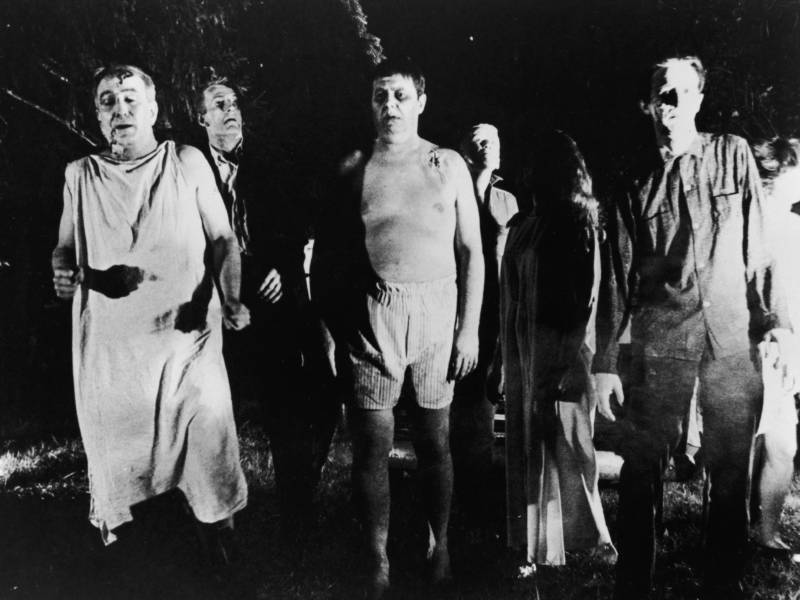 A line of zombies in a still from 'Night Of The Living Dead,' directed by George Romero, 1968. The film has been reissued for screenings on the 50th anniversary of its release.