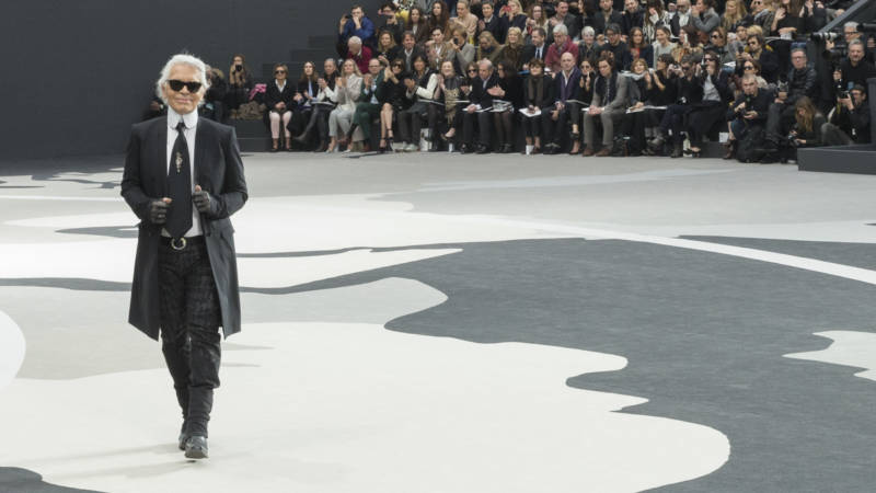 Lagerfeld acknowledges applause following a Chanel show in Paris in 2013.